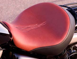 Custom designed stitch pattern with embossed leather seat enhances the look of the Shadow Phantom. Constructed with premium hand-cut leather and vinyl bands for flexibility. High quality, injection-molded factory seat pan.FITS:Shadow Phantom 2010-2011