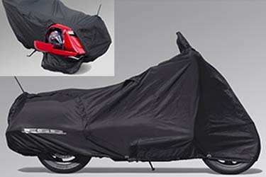 Constructed of weather-resistant synthetic material, this Cycle Cover features a moisture venting system aswell as a soft inner liner to prevent windscreen scratching. The unique zipper design allows you to access your luggage without removing the cover.