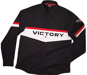 Crisp yet casual Brand shirt. Fabric: 65% polyester/35% cotton Polycotton twill; black Graphics: Applique Victory logo across the chest and woven Victory logos on the sleeves and on back Additional Features: Two chest pockets, button front, snap-down