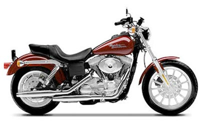 Clean low mileage Harley Davidson with highway bars and backrest.
