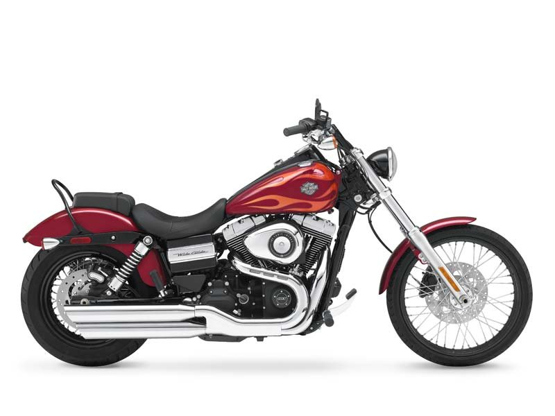 Only 64 miles on this beautiful Wide glide with factory flame paint!! Includes detachable windshield!!