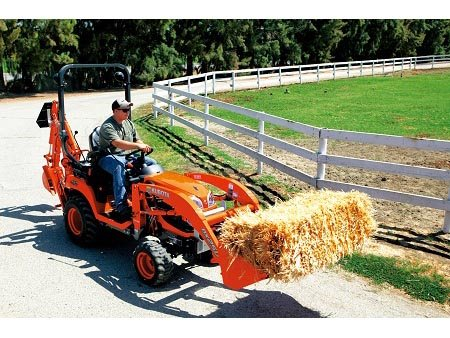 25hp compact tractor,  6' backhoe and loader,  Great for around the house and in the barn!